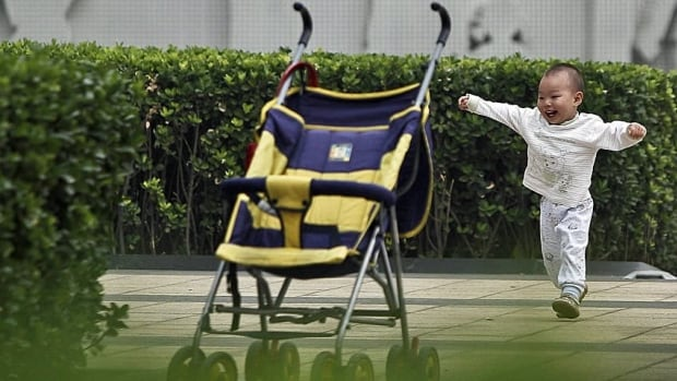 Doctors don't want to inadvertently reduce children's opportunities for outdoor play by telling parents not to use a stroller to get to a park, for instance. (Andy Wong/Associated Press)