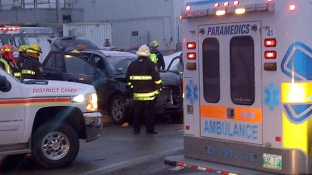 Emergency crews attend the scene of a crash on McGillivray Boulevard and the Perimeter Highway on Wednesday.
