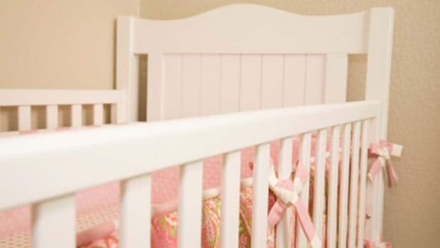 The child, called Baby Dawn in the report, fell asleep in a crib. Her foster parents brought her into bed some time during the night and found her dead in the morning.