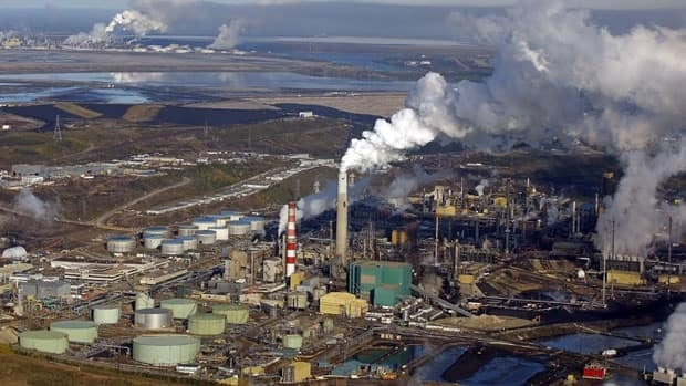 Two reports out Wednesday offer differing views on the impact of the oilsands on Canada's economy. The reports come as NDP Leader Tom Mulcair, who has raised concerns about the economic effects, gets ready to tour Suncor's oilsands facility near Fort McMurray, Alta.