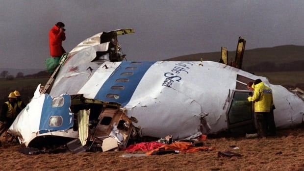 Investigators scan the wreckage of Pan Am Flight 103 in a farmer's field east of Lockerbie, Scotland, on Dec. 23, 1988, two days after the flighted exploded in mid-air.