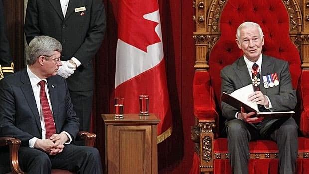 Gov. Gen. David Johnston reads the throne speech in the Senate chamber as Prime Minister Stephen Harper looks on. (Reuters)