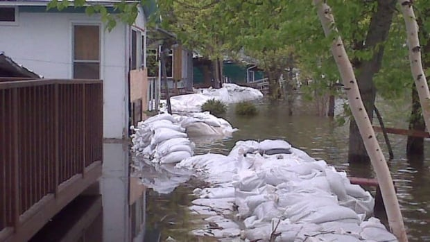 Sandbag dikes could not hold off flooding from Dauphin Lake in the spring of 2011. The Manitoba government issued a flood watch for the lake on Sunday. (Brady Strachan/CBC)