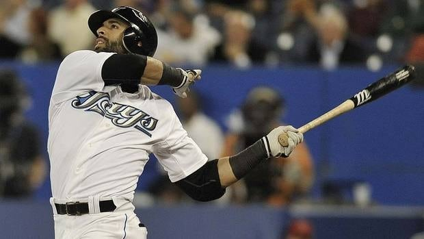 Blue Jays' Jose Bautista watches from the dugout during a game against the Minnesota Twins on Oct. 2, 2012, in Toronto .