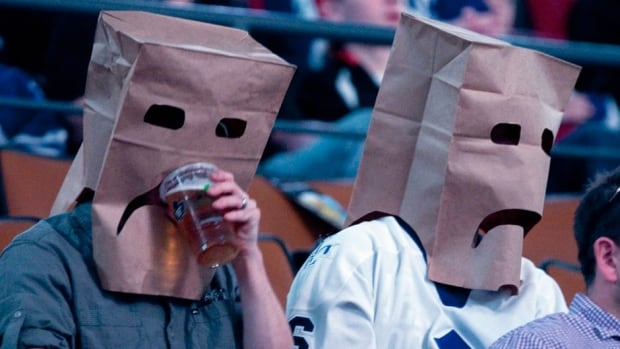 Toronto Maple Leafs fans, like these two shown here last week at Maple Leaf Square, were praised by Don Cherry for keeping things peaceful.