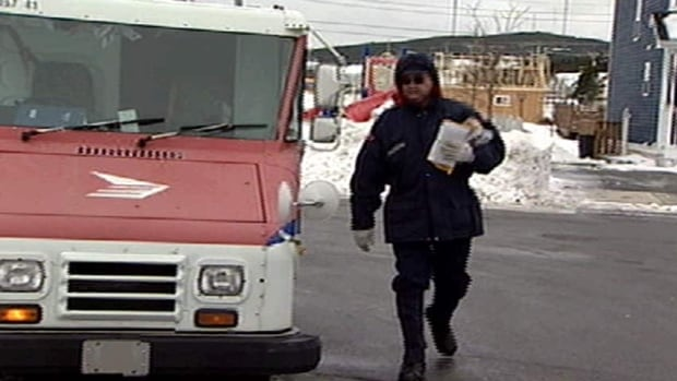 Canada Post is phasing out door-to-door delivery of regular mail to urban residents and increasing the cost of postage in a major move to try to reduce losses.