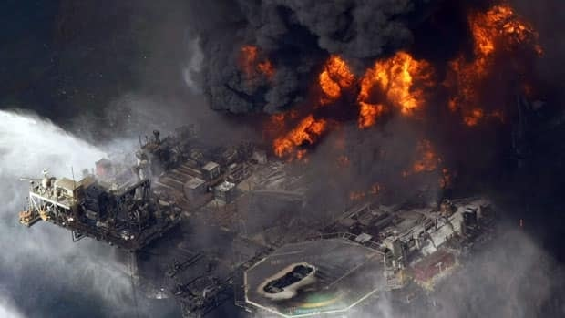 FILE - In an April 21, 2010 file aerial photo taken in the Gulf of Mexico more than 50 miles southeast of Venice, La., the Deepwater Horizon oil rig is seen burning. A U.S. judge has approved a record $4 billion criminal settlement from BP for its role in the disaster