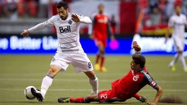 Etienne Barbara, left, is one of three players the Vancouver Whitecaps have declined to exercise their option on for 2013.