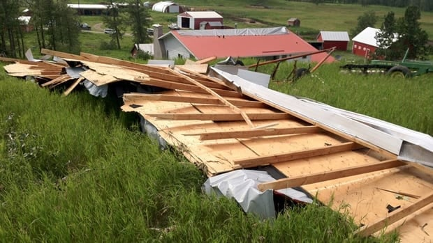 The roof of Diana Satchwell's home near Bottrel, Alta., was sent flying up a hillside by a tornado.