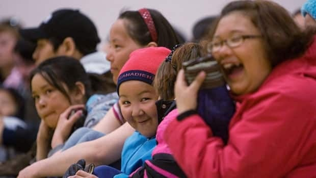 A group of children laugh at Maani Ulujuk school in Rankin Inlet, Nunavut, during a governor general's visit in 2009. A report by Active Healthy Kids Canada on 2012 activity levels across the country found children in Nunavut came out on top.