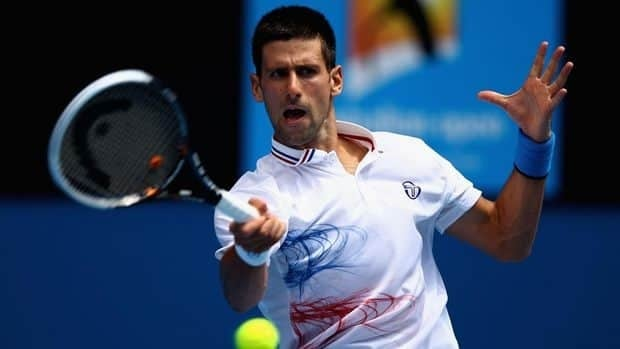 Novak Djokovic reacts after a point against Stanislas Wawrinka during their match at the Australian Open in Melbourne on January 21, 2013.