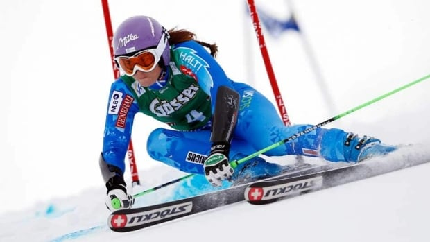 Tina Maze of Slovenia lifts the crystal globe as the winner of the overall Giant Slalom ladies World Cup at the FIS Alpine Ski World Cup finals in Lenzerheide, Switzerland, Sunday.