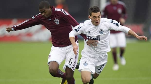 Vancouver Whitecaps FC Russell Teibert, right, is part of the young Canadian team that will try to qualify for the London Olympic Games. The qualifying tournament begins Thursday.