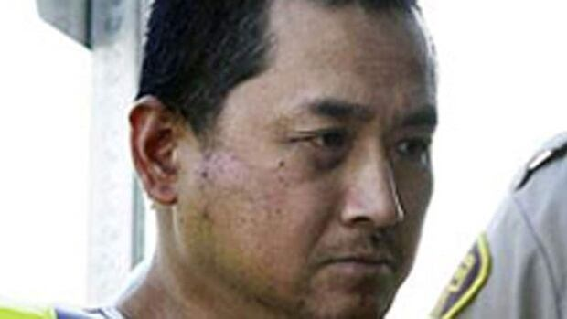 Vince Li is seen in this file photo from August 2008, being led into court in Portage La Prairie to face second-degree murder charges in the death of Tim McLean on a Greyhound bus.