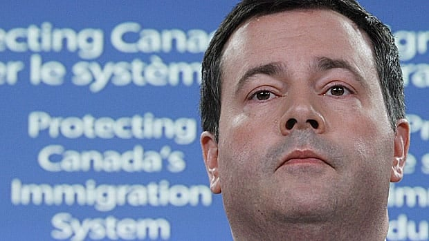 Police and border officials have broken an Ontario-based human smuggling operation, arresting 85 people, Immigration Minister Jason Kenney said Wednesday.
