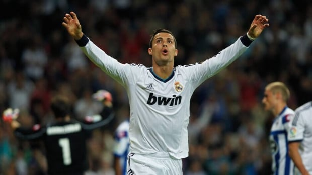 Cristiano Ronaldo, right, of Real Madrid celebrates scoring the opening goal with Mesut Oezil during the UEFA Champions League quarter-final first leg match at Estadio Santiago Bernabeu on Wednesday in Madrid, Spain.