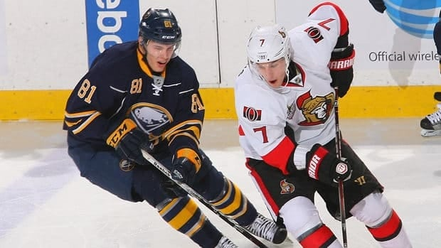 Kyle Turris of the Ottawa Senators, centre, skates with the puck against Shawn Matthias of the Florida Panthers at Scotiabank Place on January 21, 2013 in Ottawa.