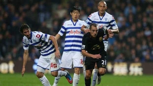 Everton player Leon Osman (21) scores the third Everton goal against Oldham during FA Cup action.