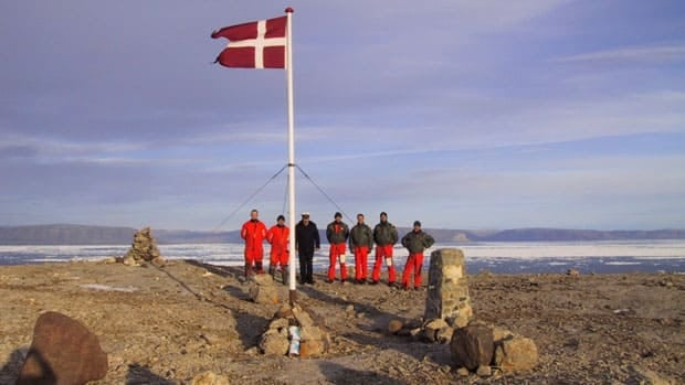 The crew of the Danish warship Vedderen perform a flag raising ceremony on uninhabitated Hans Island in August 2002. The island is midway between Ellesmere Island and Greenland, and both Canada and Denmark claim sovereignty over it.