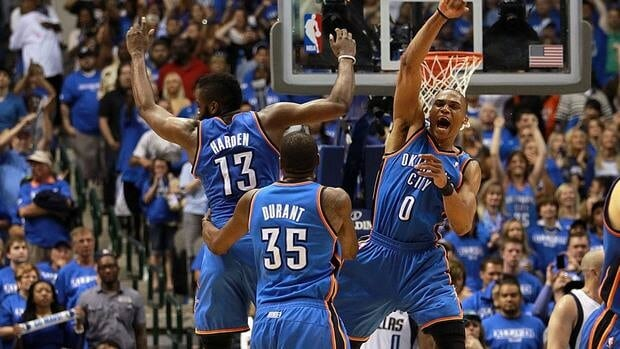 James Harden, left, Kevin Durant, centre, and Russell Westbrook of the Oklahoma City Thunder celebrate against the Dallas Mavericks during Game 4 of the Western Conference Quarterfinals.