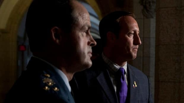 Chief of Defence Staff Tom Lawson, left, and Defence Minister Peter MacKay, seen here announcing Lawson's appointment last August, are under pressure to trim defence budgets. New figures suggest headquarters spending hasn't been cut the same as front-line forces.