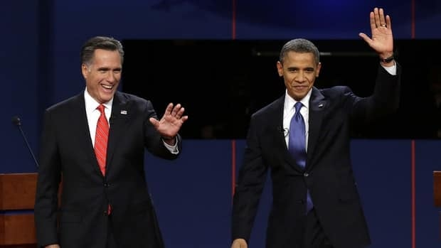 Republican presidential candidate Mitt Romney and President Barack Obama wave to the audience during the first presidential debate at the University of Denver.