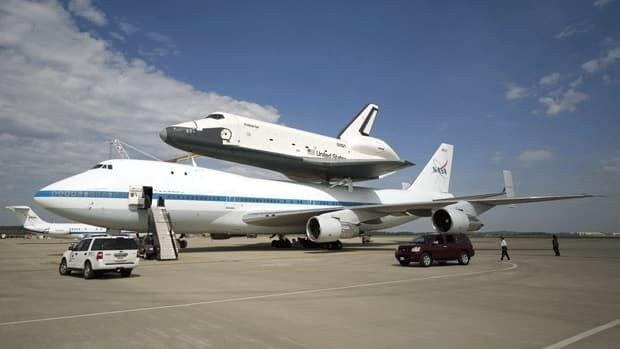 The space shuttle Enterprise is mated on top of the NASA 747 Shuttle Carrier Aircraft at Washington Dulles International Airport, in Sterling, Va. The flight was pushed back until April 27 due to inclement weather in the East Coast.