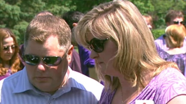 Patrick and Sheri Leighton, seen here at a memorial service held a year after their son Eric Leighton's death, have filed a $400,000 lawsuit against the Ottawa Catholic School Board and the teacher in charge of the shop class where the student was killed.