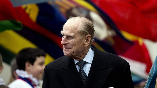 Prince Philip, the husband of Queen Elizabeth, walks past the flags of the Commonwealth in London on March 11. He has been admitted to hospital, Buckingham Palace says.
