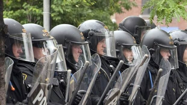 Misconduct charges were laid against more than 30 officers related to the G20 summit in which vandals went on a rampage and police made one of the largest mass arrests — more than 1,000 people — in Canadian history.
