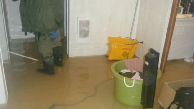 Residents in Attawapiskat start to clean up after sewers backed up into basements.