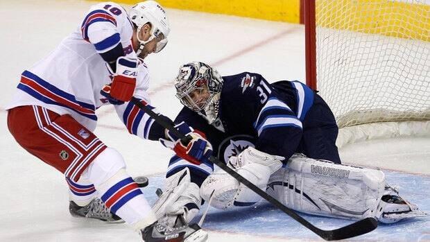 Winnipeg Jets goaltender Ondrej Pavelec (31) stops New York Rangers forward Marian Gaborik (10) on a breakaway during first period Thursday.