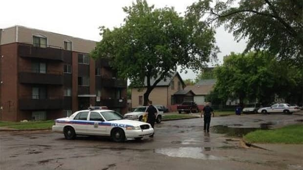 A boy, 15, is facing an attempted murder charge after this Saskatoon building was shot at, breaking two windows.