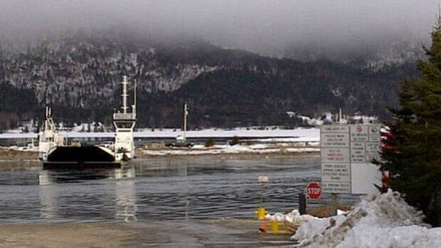 The Englishtown ferry was tied up Tuesday to allow searchers to look for a missing vehicle.