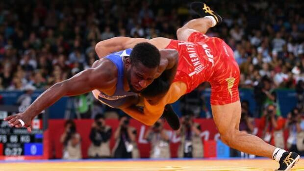Canada's Haislan Veranes Garcia, left, is thrown to the mat by Tatsuhiro Yonemitsu of Japan in men's 66-kilogram freestyle wrestling match at the London Olympics on Aug. 12, 2012.