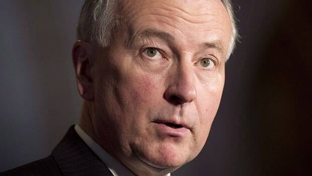 Justice Minister Rob Nicholson speaks to reporters in the foyer of the House of Commons on Wednesday, May 1. He said the government supports a private member's bill from Conservative MP Parm Gill on gang recruitment.