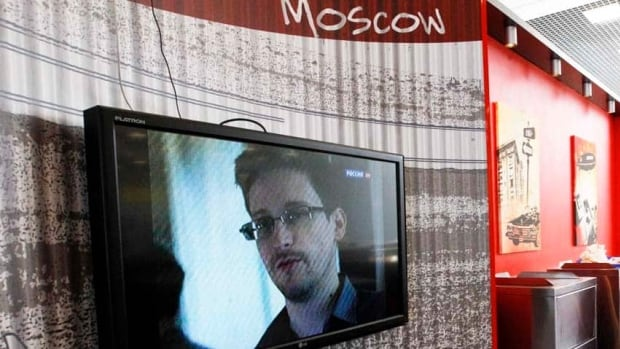 Former U.S. spy agency contractor Edward Snowden is shown during a news bulletin at Moscow's Sheremetyevo airport. Snowden, who is in the transit area of the airport, has requested asylum from Venezuela, President Nicolas Maduro has confirmed.