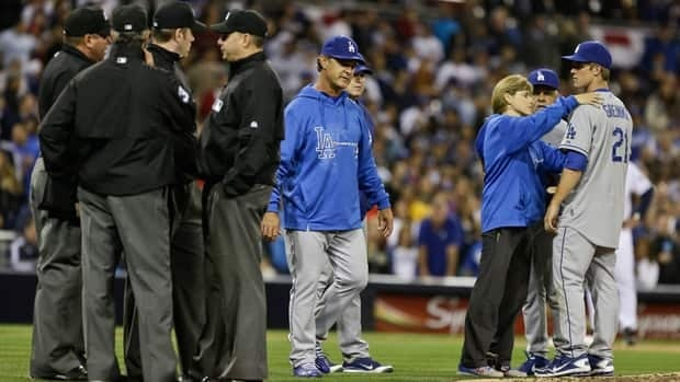 Los Angeles Dodgers pitcher Zack Greinke is attended to by the team trainer after the brawl against the San Diego Padres on April 11, 2013.