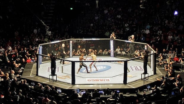 Two fighters face off at a professional mixed martial arts tournament in Seattle, Wash., on Dec. 8, 2012.