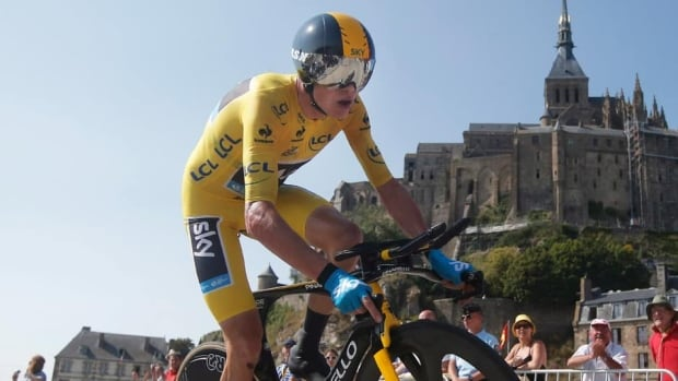 Chris Froome, shown in this file photo, won the 17th stage of the Tour de France on Wednesday by holding off Alberto Contador in the time trial.
