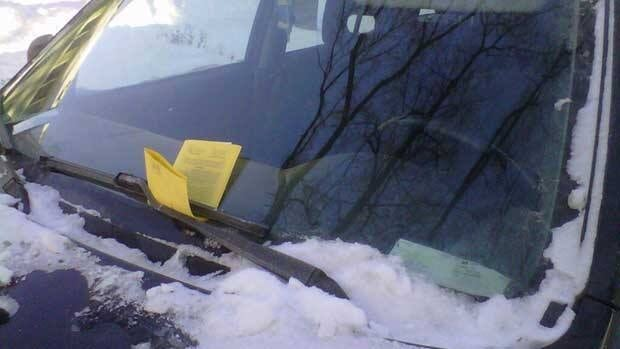Parking tickets on a car in Winnipeg on Wednesday afternoon, as city crews continue to clear snow on residential streets.