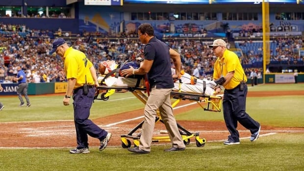 Tampa Bay Rays starting pitcher Alex Cobb lies on a stretcher as he is taken off the field by medical personnel after being hit by a line drive by Kansas City Royals' Eric Hosmer during the on Saturday.
