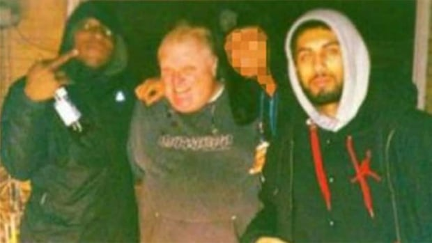 Muhammad Khattak, far right, appears in this notorious photo standing beside Toronto Mayor Rob Ford. Khattak's lawyer has argued that his client was not involved in the making of a video now linked to the photo.