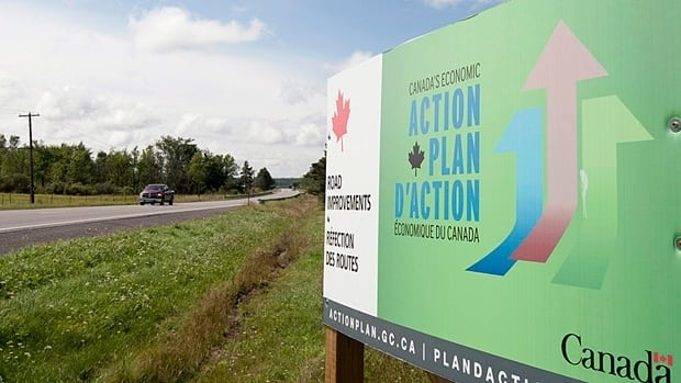 A 2010 Economic Action Plan advertisement is seen along a road near Mississippi Mills, Ont.  A tender has been issued to hire a firm to manage up to three more years of broadcast, print and digital advertising to continue the Economic Action plan campaign.
