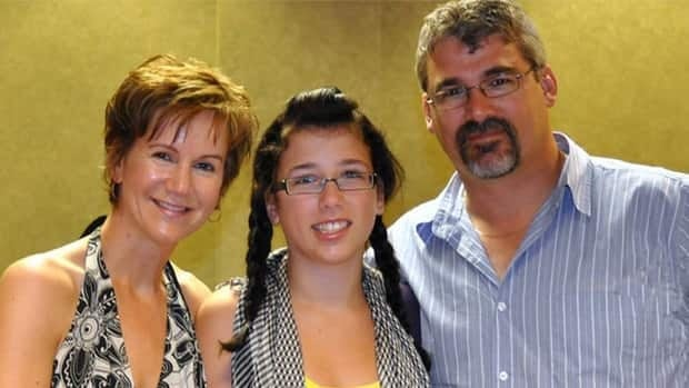 Rehtaeh Parsons with her father Glen Canning and an unnamed woman.