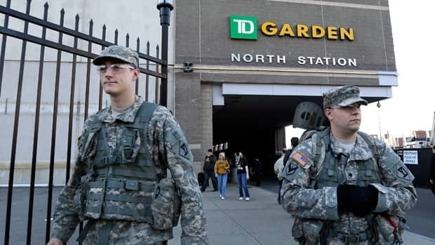 United States soldiers walk outside TD Garden before the Bruins' home game Wednesday against Buffalo.