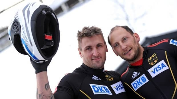 Germans Kevin Kuske and Thomas Florschuetz, shown in this file photo, were one of two teams that tied for gold with a second run time of 1:54.15