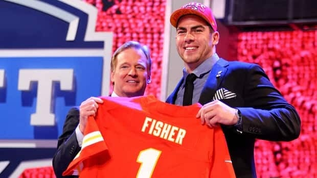 Eric Fisher of Central Michigan Chippewas, right, stands on stage with NFL commissioner Roger Goodell during the draft at Radio City Music Hall on April 25, 2013 in New York City.