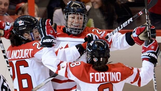 Team Canada's Natalie Spooner, centre, celebrates her goal with teammates Laura Fortino, right, and Sarah Vaillancourt during the second period of Monday's semifinal at the women's world hockey championship.