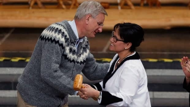 Sweden's Foreign Minister Carl Bildt hands the gavel which symbolizes handing the chairmanship of the Arctic Council to Canada's Minister of the Arctic Council Leona Aglukkaq, at the Arctic Council Ministerial Meeting, in Kiruna, Sweden, on Wednesday.